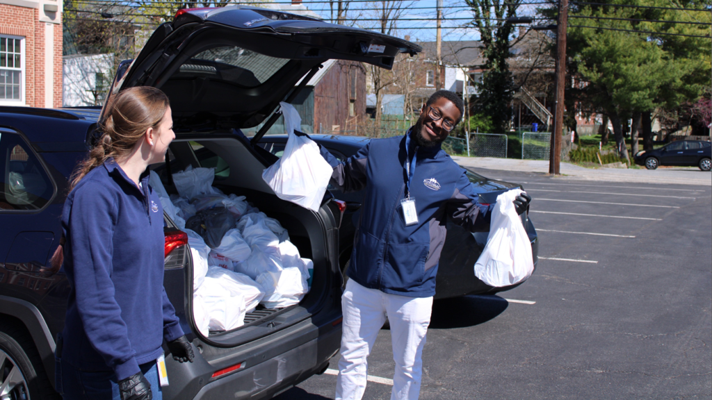 As part of a case management career, PCMS staff get many opportunities for outreach, like these PCMS staff who hold bags filled with groceries for the community.