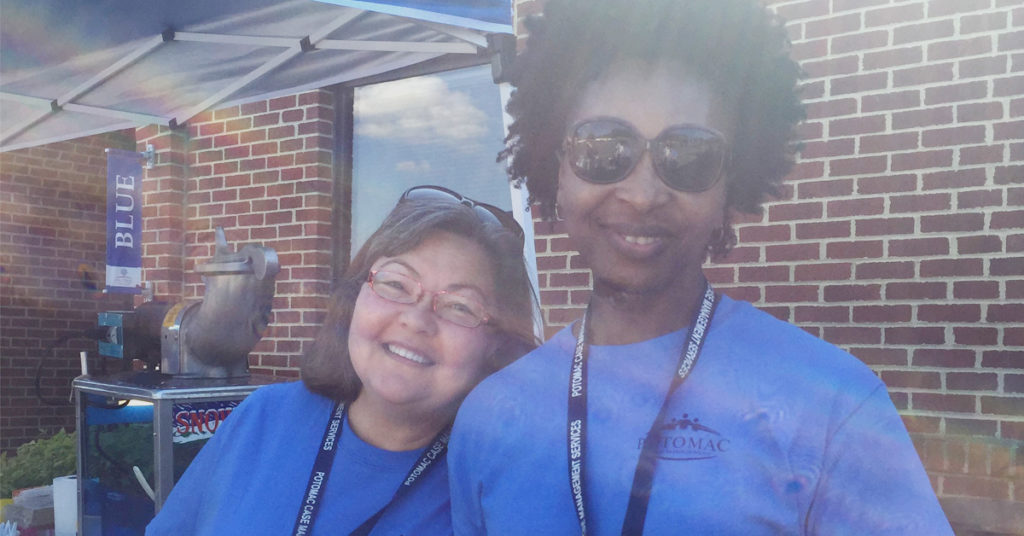 Potomac Case Management Services staff smiling while serving at an event,